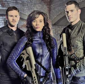 "Aaron Ashmore (left) Hannah John-Kamen, and Luke Macfarlane costar in the Syfy Channel's latest thriller, ""Killjoys."""